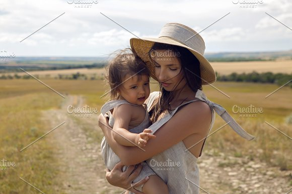 mother and son standing in the field