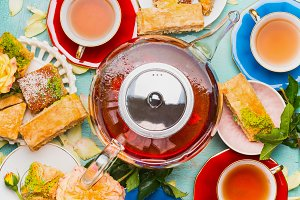 Tea break with cups, flowers ,cakes