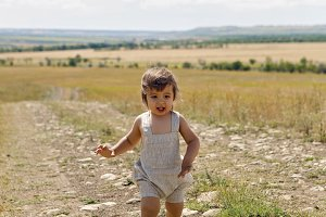 baby boy running across the field at