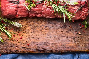 Raw roast beef  with ingredients