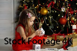 Little girl next to Christmas tree