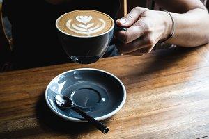 Girl having cappuccino coffee break