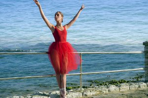 Pretty dancer woman on red dress