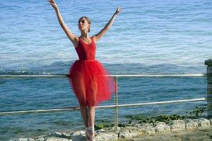 Pretty dancer woman on red dress