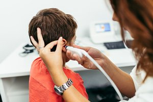 Young boy hearing aid