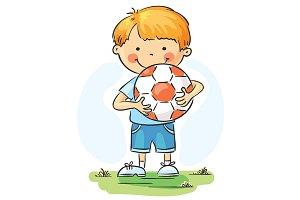 Little boy holding football