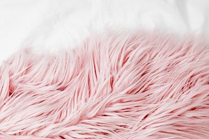 Bedding with a pink fluffy fur plaid
