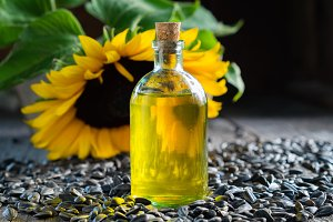 Bottle of oil, seeds and sunflower.