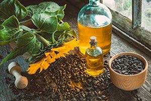 Oil bottles, mortar and sunflower.