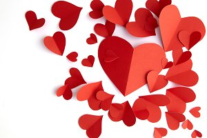 Red paper hearts on white