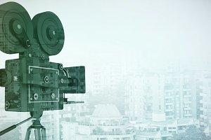Black film reel camera with tripod