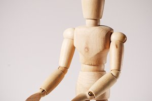 Wooden mannequin for painting on a white background