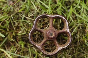 old rusty valve in the grass