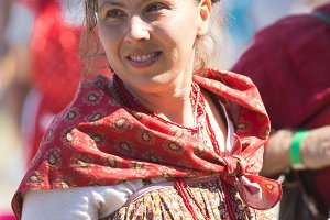 A woman in Russian folk clothes with