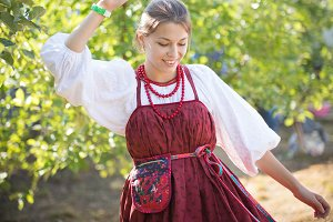 Beautiful young girl in Russian folk