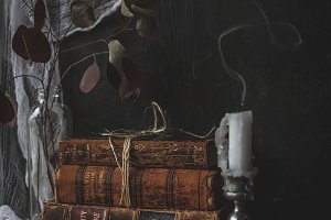 old books and smoking candle