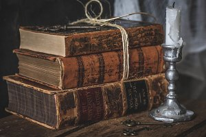 vintage books and candle