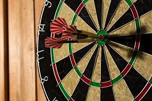 The darts isolated on wooden back
