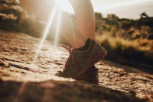 Female trail runner standing
