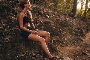 Sportswoman relaxing on trail run
