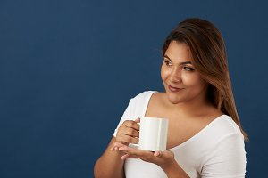 Latina woman with cup tea