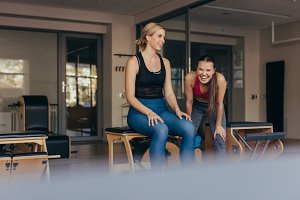 Happy pilates women at a gym