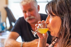 Couple Enjoying Glasses of Beer