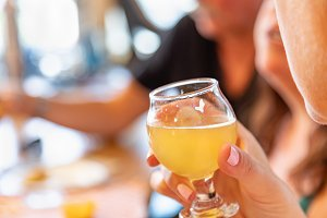 Female Hand Holding Glass of Beer