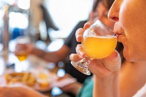 Female Sipping Glass of Beer