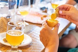 Woman Enjoys Warm Pretzels and Beer
