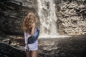 beautiful woman travel waterfall