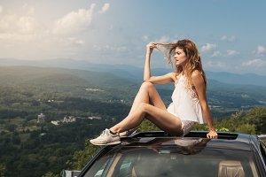 Beautiful woman travel by car