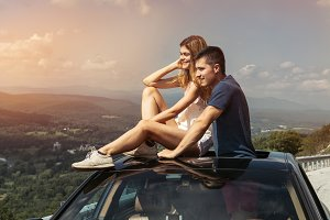 couple on road trip travel by car