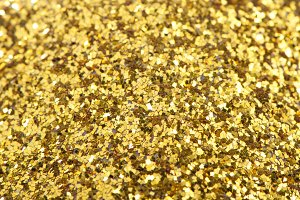 Background of gold sparkles, sweets