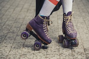 female legs in roller skating