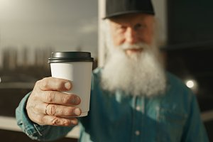 old man with beard and coffee