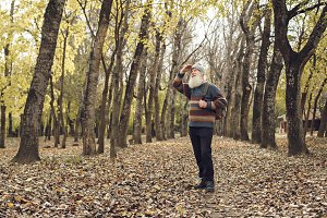 old man with beard in forest