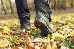 feet boots autumn leaves