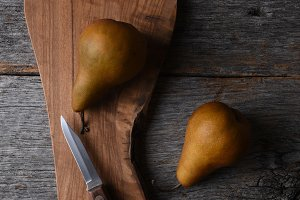 Pears on a cutting board with knife