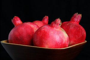 Pomegranates in Wood Bowl