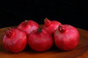 Pomegranates on Wood Platter