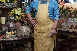 Old Man florist in flower shop