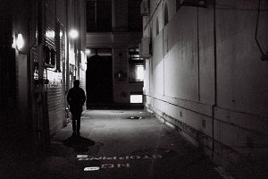 Man standing in Alley way