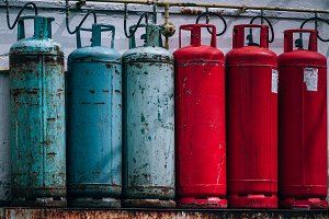 Blue and Red Gas Tank at Back Street