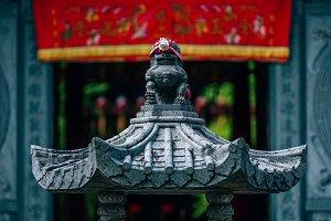 Gray Lion Statue Guarding Entrance