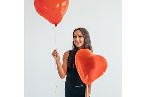 Beautiful woman posing with balloons