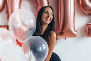 Girl posing with balloons Playing