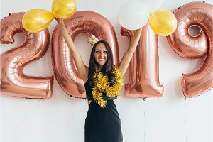 Young woman with balloons posing