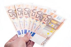Hand giving fifty euro fan