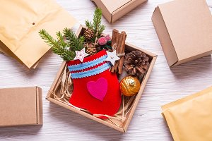 Handmade mitten in cardboard box, Ch